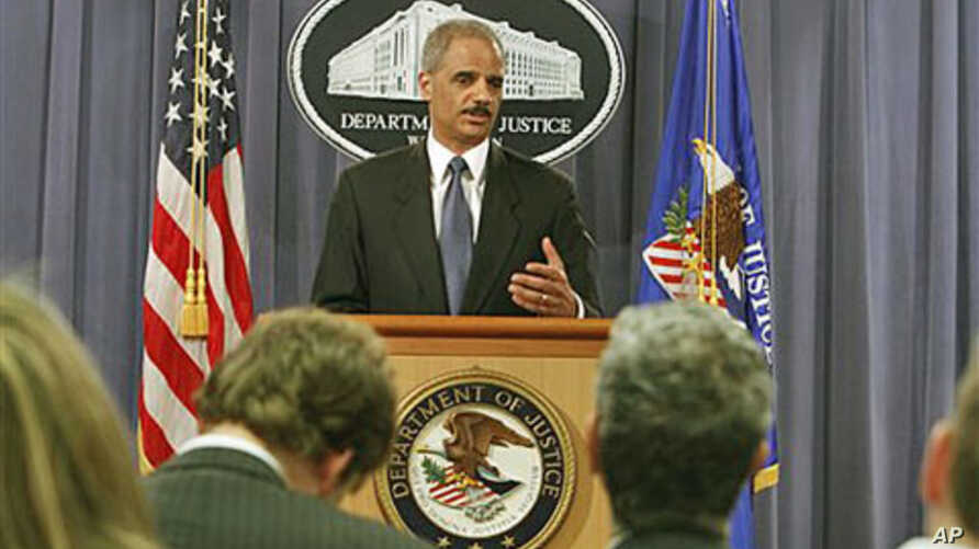 Attorney General Eric Holder gestures during a news conference at the Justice Department in Washington, where he announced plans to try avowed 9/11 mastermind Khalid Sheikh Mohammed and four alleged henchmen before a military commission, April 4, 201