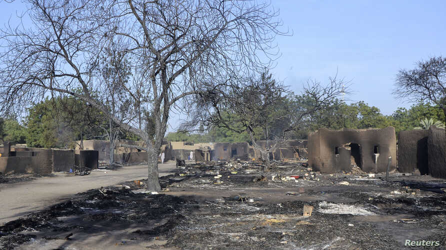A view shows a burnt compound after an attack by Boko Haram militants in the village of Ngouboua, Feb. 13, 2015. Boko Haram fighters attacked the village in Chad on Friday.