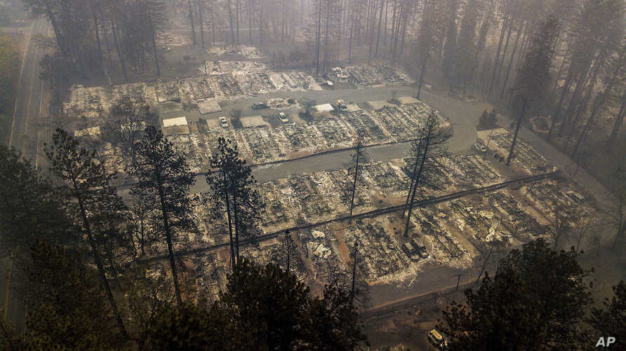 Residences leveled by the wildfire line a neighborhood in Paradise, Calif., on Nov. 15, 2018.