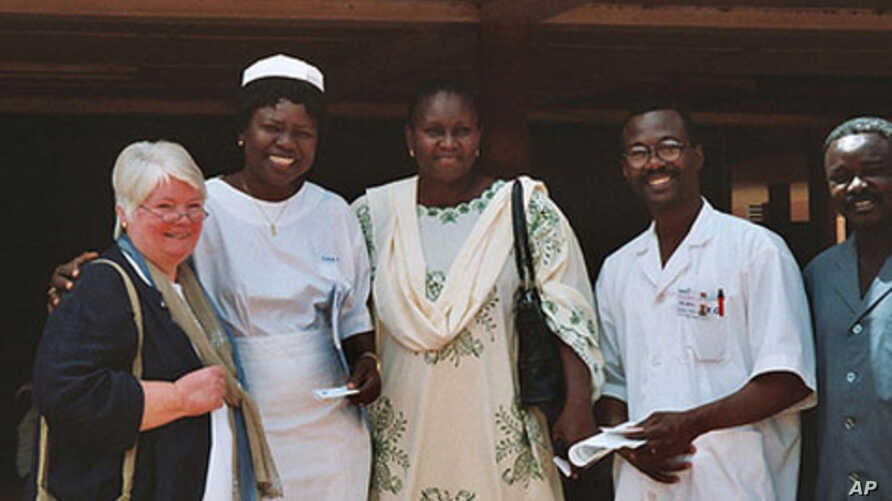 Jill Sheffield with staff at a clinic in Burkina Faso, where FCI has successfully implemented an effective model of maternal health care delivery.