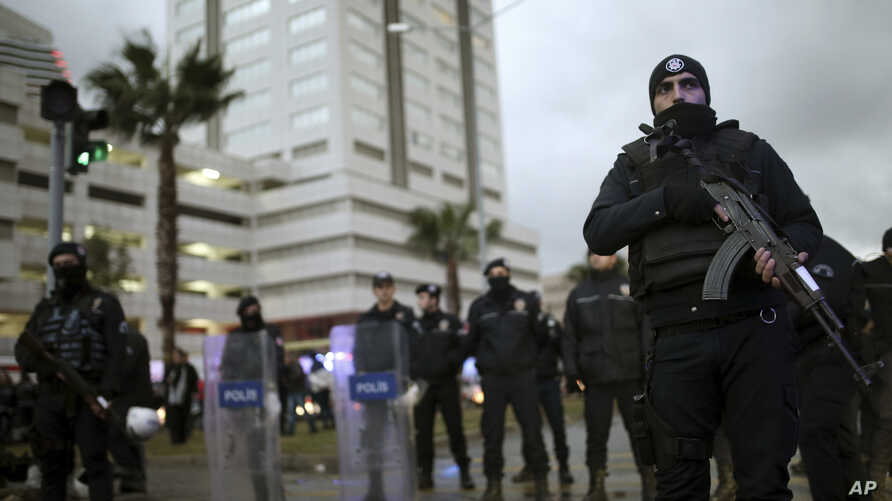 Police officers stand guard at the site of an explosion, in Izmir, Turkey, Jan. 5, 2017.
