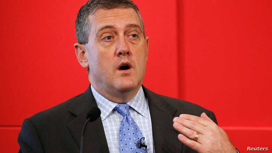 FILE - St. Louis Federal Reserve President James Bullard speaks at a public lecture in Singapore, May 26, 2016.