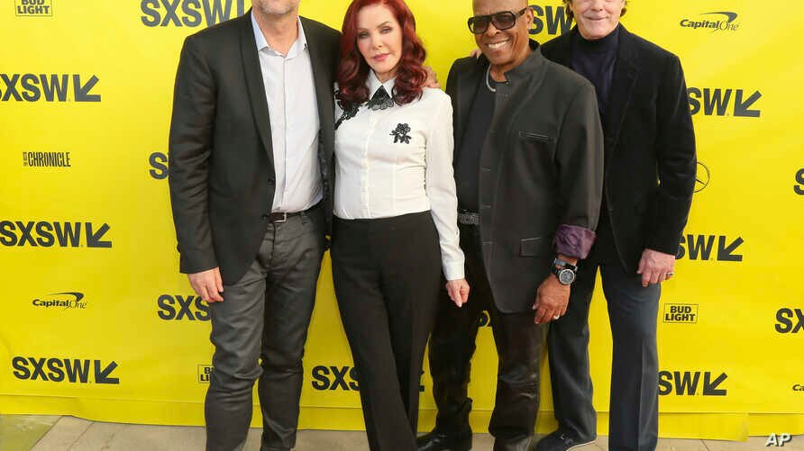 """Director Thom Zimny, from left, executive producer Priscilla Presley, David Porter and Jerry Schilling, arrive for the world premiere of """"Elvis Presley: The Searcher"""" during the South by Southwest Film Festival at the Zach Theatre on Wednesday, March"""