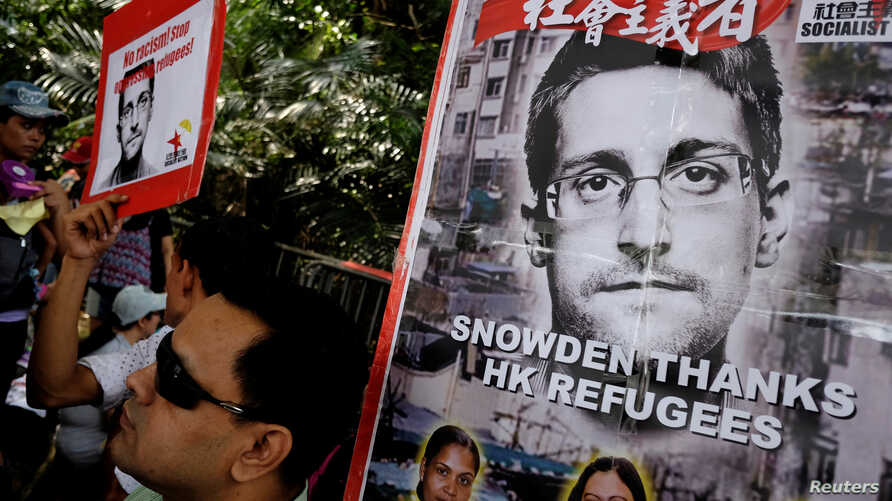 Refugees and protesters supporting Edward Snowden demonstrate outside the U.S. Consulate as they demand that U.S. President Barack Obama grant Snowden a pardon, in Hong Kong, China Sept. 25, 2016.