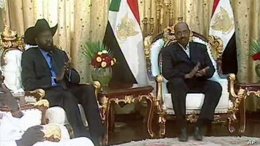 Sudanese President Omar Hassan al-Bashir and General Salva Kiir (L), first vice-president of Sudan and governor of Southern Sudan, is seen at the presidential palace in Khartoum in this video frame grab taken February 7, 2011.