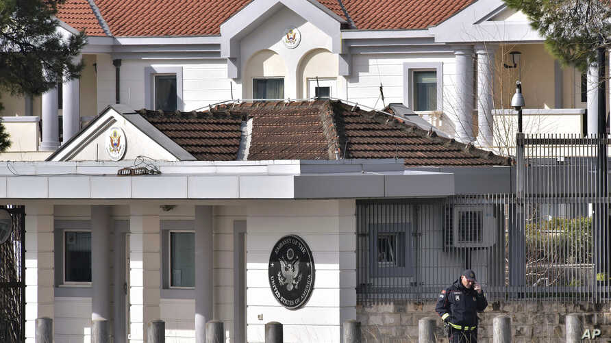 A police officer stands guard outside the U.S. embassy in Montenegro's capital Podgorica, Feb. 22, 2018.