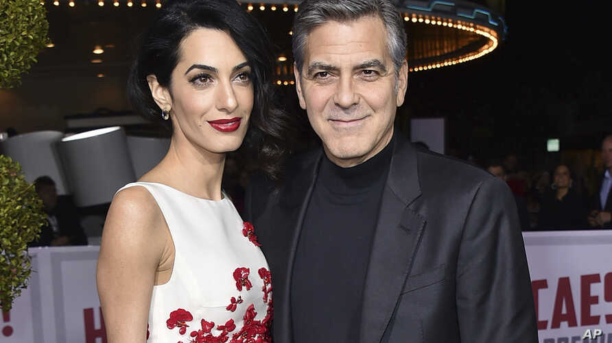 """FILE -  Amal Clooney, left, and George Clooney arrive at the world premiere of """"Hail, Caesar!"""" in Los Angeles."""