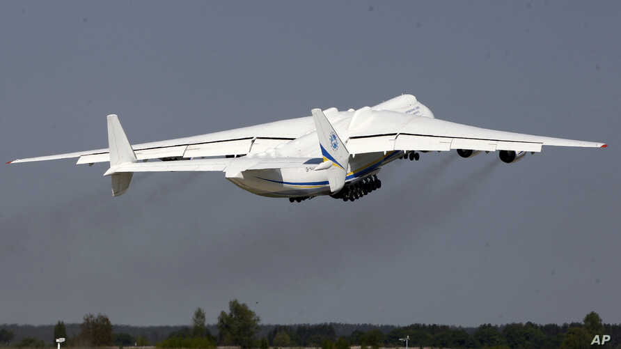 The world's largest airplane, Ukrainian Antonov An-225 Mriya takes off at the  airport  near Hostomel near Kiev , Ukraine, Tuesday, May 10, 2016.