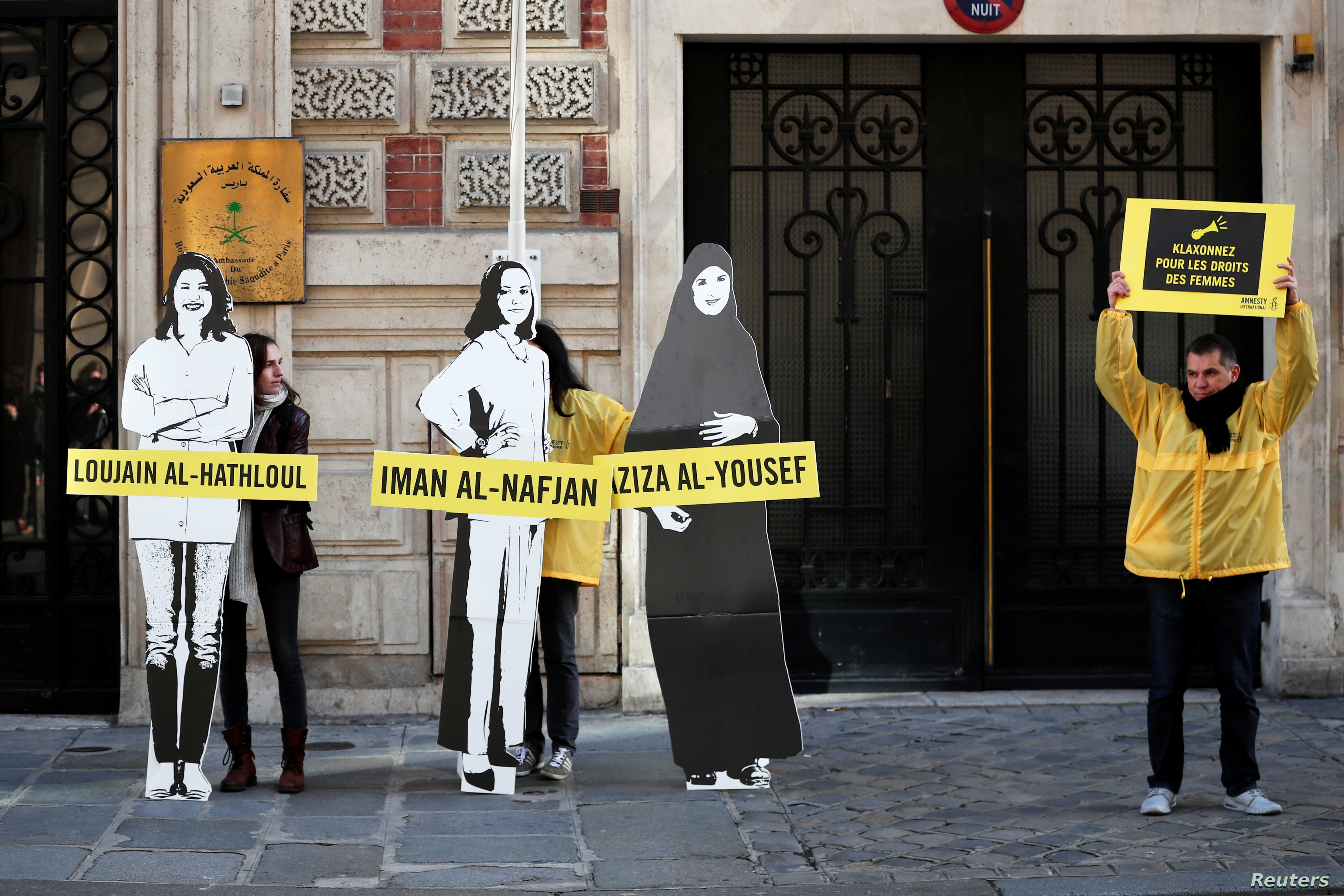 FILE - Demonstrators from Amnesty International stage the protest on International Women's day to urge Saudi authorities to release jailed women's rights activists Loujain al-Hathloul, Eman al-Nafjan and Aziza al-Yousef outside the Saudi Arabian Emba