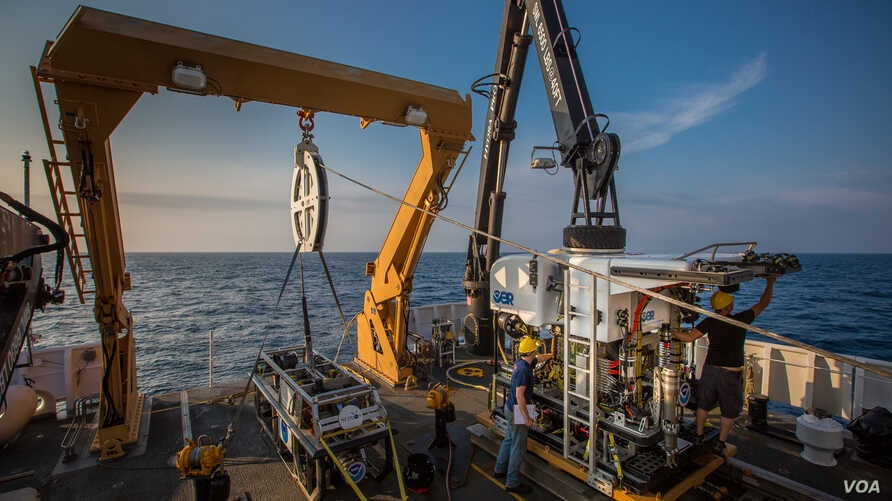 The remotely operated vehicles, Seirios and Deep Discoverer, are seen aboard NOAA's Okeanos ship.