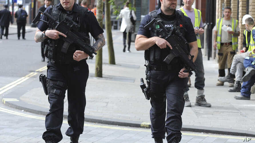 Armed police patrol the streets near to Manchester Arena in central Manchester, England, May 23, 2017.