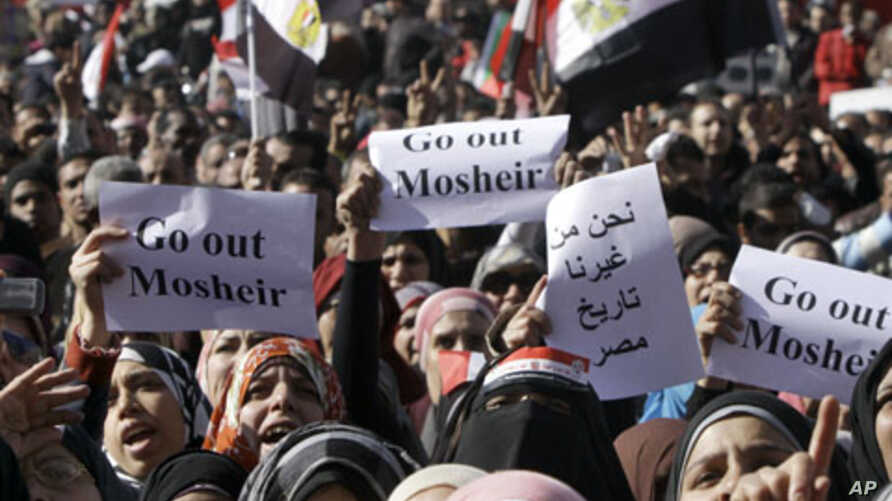 Egyptian women protesters shout as they raise slogans demanding the head of the military ruling council to step out at Tahrir Square in Cairo, Egypt, December 23, 2011.