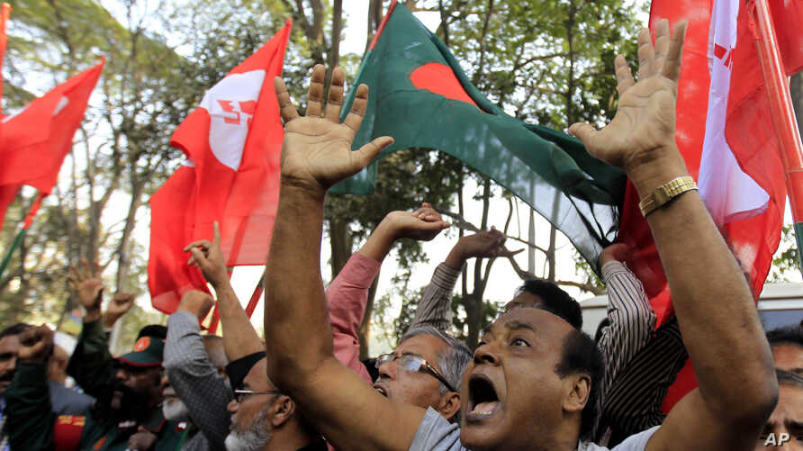 Bangladeshi activists shout slogans as they celebrate outside the International Crimes Tribunal where leaders of the country's largest Islamic party the Jamaat-e-Islami party are on trial in Dhaka, Bangladesh, Feb. 5, 2013.