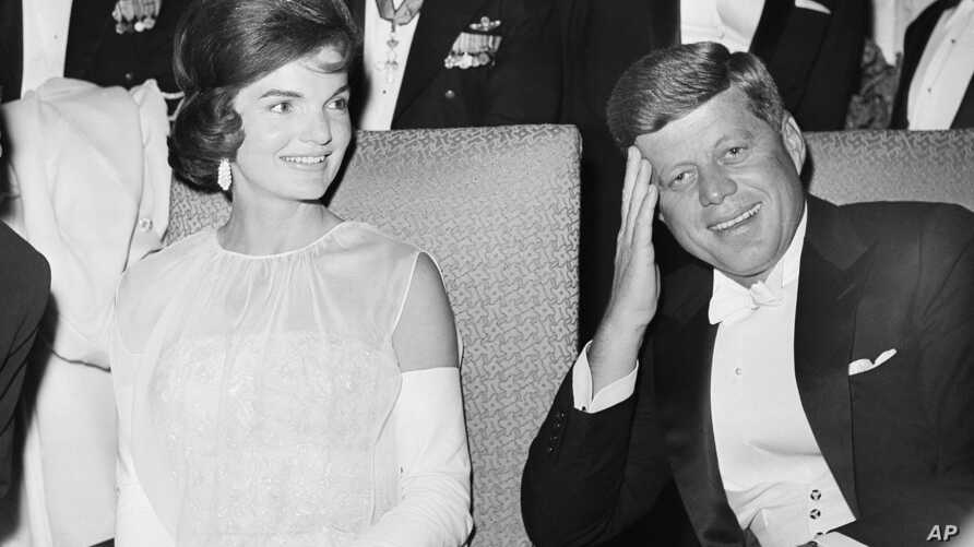 FILE - President John F. Kennedy and first lady Jacqueline Kennedy are seated as they attend one of five inaugural balls in Washington, D.C., Jan. 20, 1961.