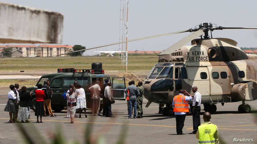 A Kenya Air Force helicopter trans.porting the bodies of Ugandan Army personnel who died in a helicopter crash on Mount Kenya on Sunday is parked on the tarmac at Wilson Airport in Nairobi, Kenya, August 15, 2012