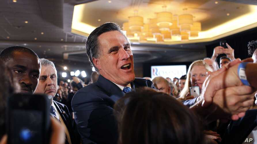 Republican presidential candidate, former Massachusetts Gov. Mitt Romney, greets supporters at his election night party in Boston, Tuesday, March 6, 2012. (AP)