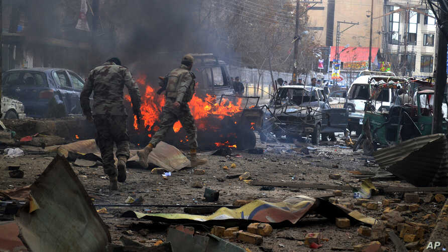 Paramilitary soldiers visit an area hit by a bomb attack in Quetta, Pakistan, March 14, 2014.