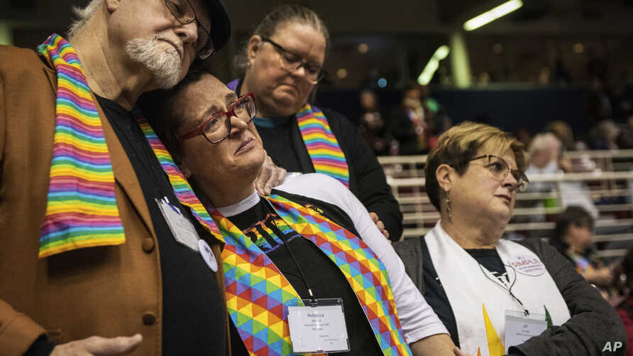 Ed Rowe, left, Rebecca Wilson, Robin Hager and Jill Zundel, react to the defeat of a proposal that would allow LGBT clergy and same-sex marriage within the United Methodist Church at the denomination's 2019 Special Session of the General Conference i