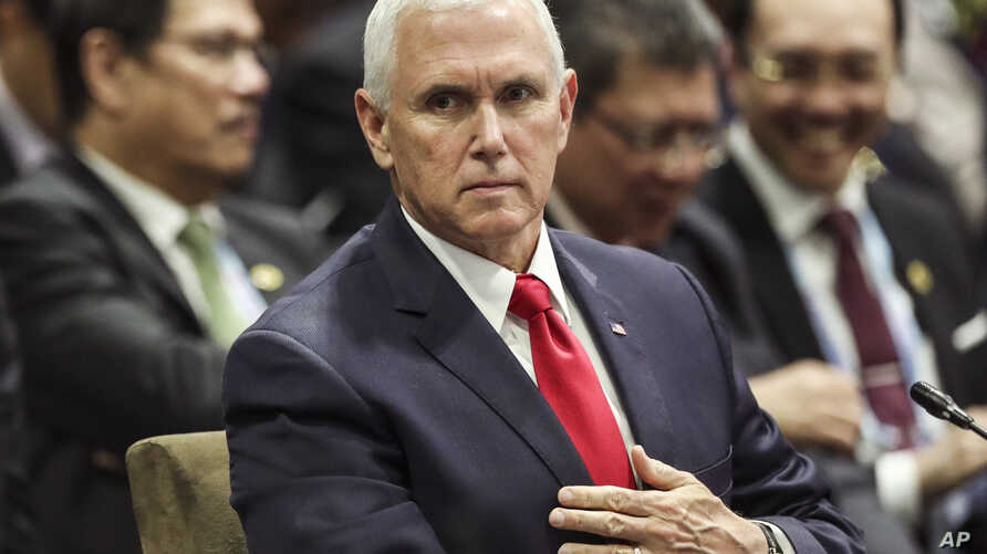 U.S. Vice President Mike Pence attends the 13th East Asian Summit Plenary on the sidelines of the 33rd ASEAN summit in Singapore, Nov. 15, 2018.