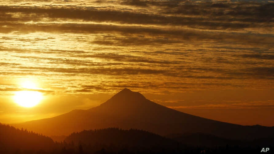 FILE - Aftermath of the largest solar storm in years, over Portland, Oregon, March 8, 2012.