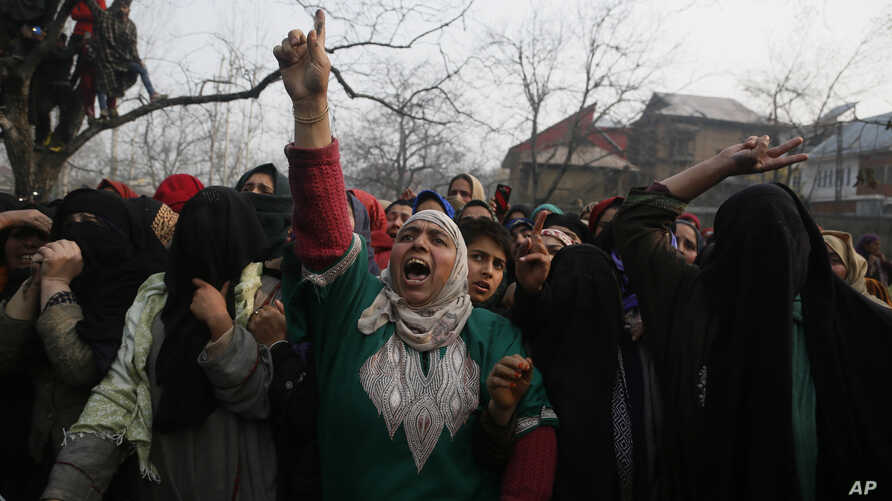 A Kashmiri woman shouts pro freedom slogans during the funeral of killed rebel Khalid Farooq, in Shopian village, south of Srinagar, Indian-controlled Kashmir, Nov. 25, 2018.
