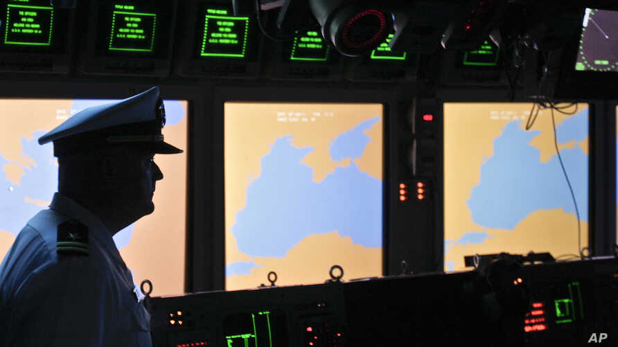 FILE - A U.S. Navy officer stands on the weapons control deck of the USS Monterey as screens display the Black Sea region, in the Black Sea port of Constanta, Romania, June 7, 2011. U.S. and NATO officials will declare operational a missile defense s