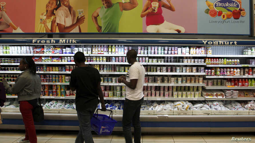 FILE - Shoppers are seen in the dairy section of a supermarket in Kenya's capital Nairobi, July 18, 2014.