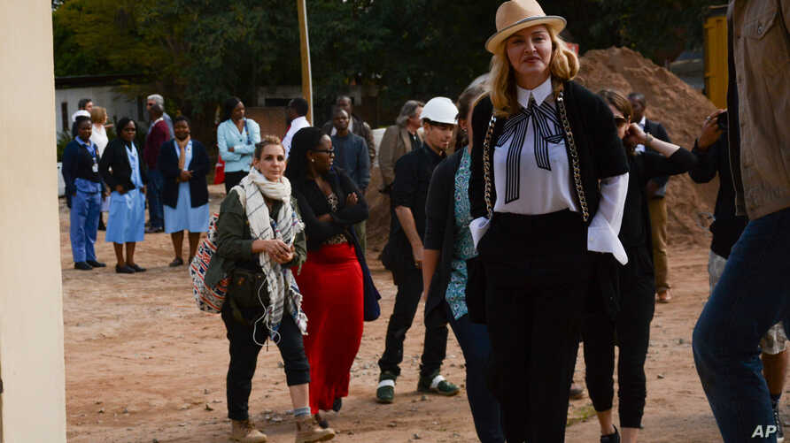 US performer Madonna visits the paediatric surgery and Malawi's first ever intensive care unit at Queen Elizabeth Central Hospital in the southern city of Blantyre, July 10, 2016.