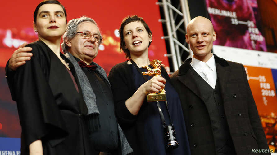 "Director, screenwriter, editor and producer Adina Pintilie and cast members pose with the Golden Bear award for best film, ""Touch Me Not,"" at the news conference after the awards ceremony at the 68th Berlinale International Film Festival in Berlin, G"