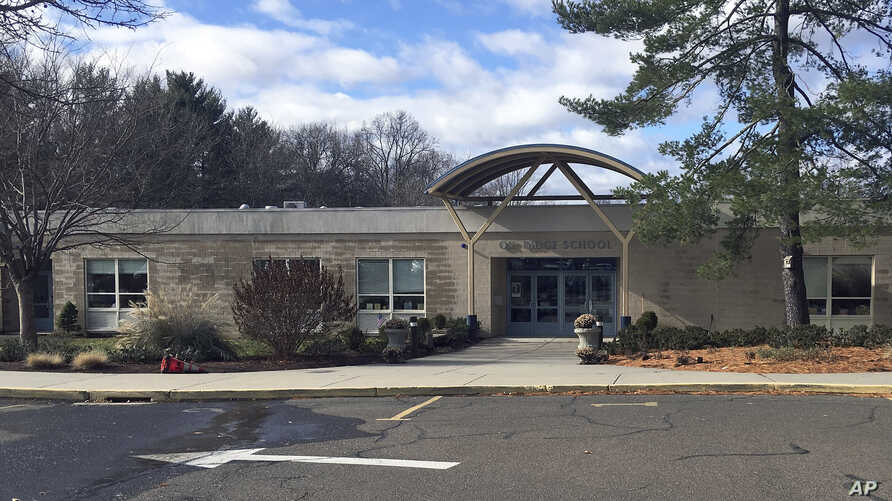 The Ox Ridge Elementary School is seen in Darien, Conn., Nov. 27, 2018. The Darien school system said parents are no longer welcome to have lunch with their children at the town's elementary schools.
