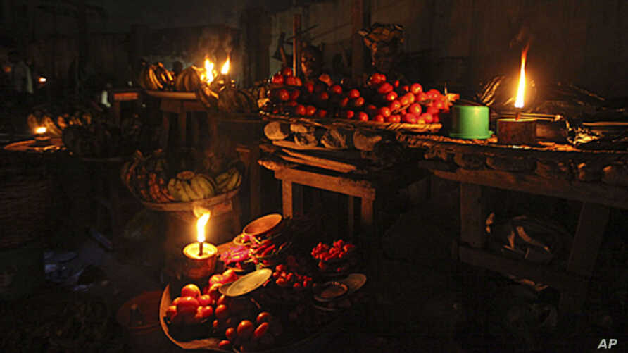 Vegetable sellers ply their wares by the light of locally-made lanterns in Lagos, Nigeria (file photo).