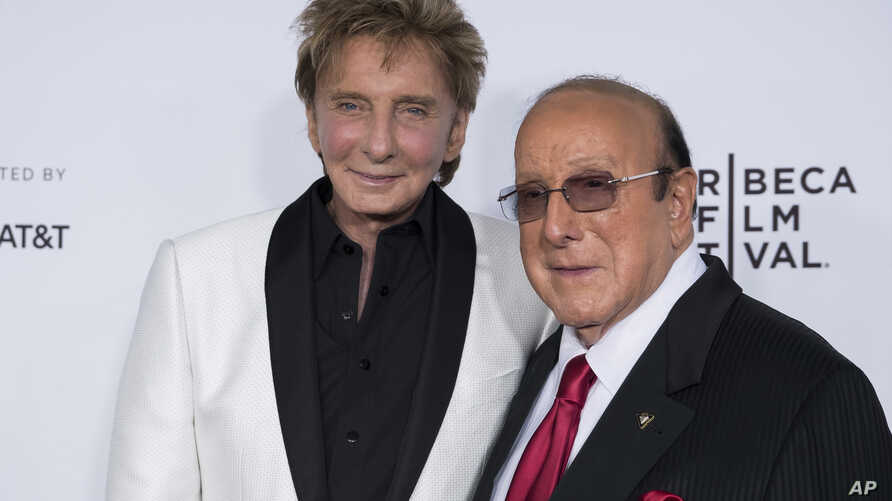 """Barry Manilow, left, and Clive Davis attend the world premiere of """"Clive Davis: The Soundtrack of Our Lives"""" at Radio City Music Hall, during the 2017 Tribeca Film Festival, April 19, 2017, in New York."""