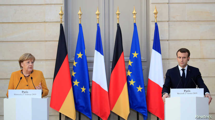 French President Emmanuel Macron and German Chancellor Angela Merkel attend a joint news conference at the Elysee Palace in Paris, France, Feb. 27, 2019.
