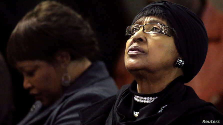 FILE - Winnie Madikizela-Mandela, ex-wife of former South African President Nelson Mandela, and her daughter Zindzi attend a prayer service for the ailing Mandela at a church in Johannesburg, July 5, 2013.