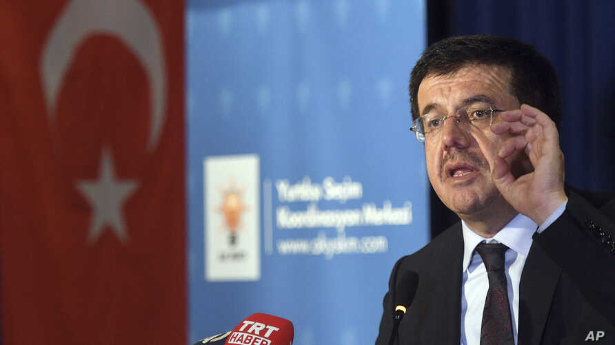 FILE - Turkish Minister of Economic Affairs Nihat Zeybekci speaking inside a hotel in Cologne, Germany.