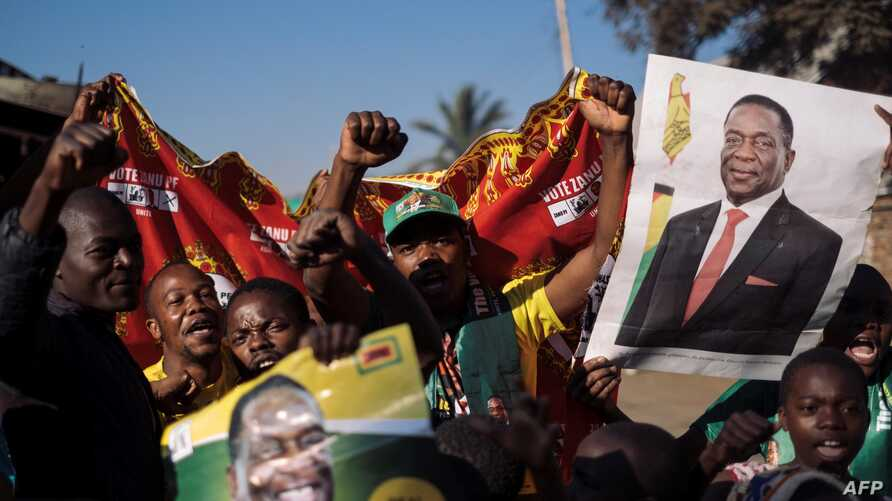 Supporters of the newly elected Zimbabwe President Emmerson Mnangagwa celebrate in Mbare, Harare, Aug. 3, 2018. Mnangagwa, a former ally of Robert Mugabe, won 50.8 percent of the vote, ahead of Nelson Chamisa of the opposition MDC party at 44.3 perce...