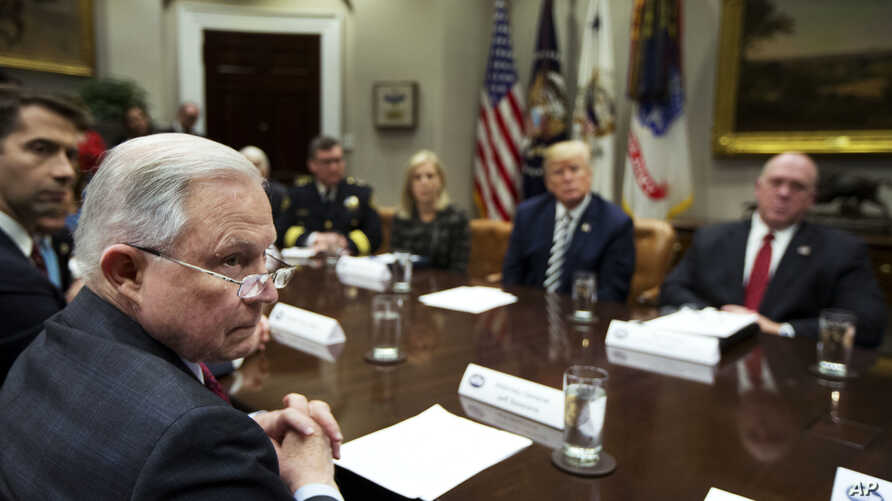 From back center clockwise; Homeland Security Secretary Kirstjen Nielsen, President Donald Trump, Immigration and Customs Enforcement Deputy Director Thomas Homan, Attorney General Jeff Sessions and Sen. Tom Cotton, R-Ark., listen to law enforcement