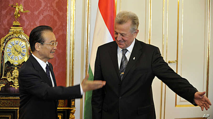 Chinese Prime Minister Wen Jiabao and Hungarian President Pal Schmitt, greet each other before meeting in Budapest, Hungary, June 25, 2011