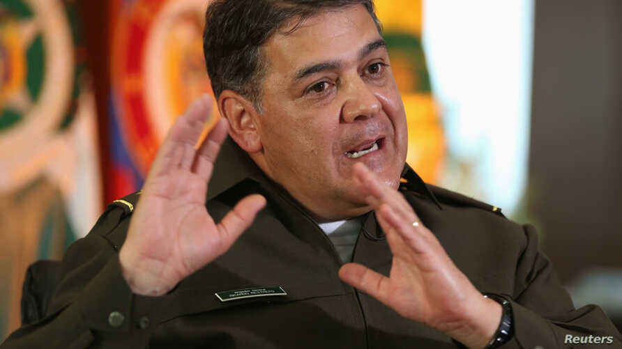 FILE- Colombian anti-narcotics police chief General Ricardo Restrepo gestures during an interview at the anti-narcotics military base in Bogota, Nov. 25, 2013.