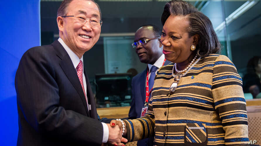United Nations Secretary General Ban Ki-moon, left, greets Central African Republic President Catherine Samba-Panza as he arrives for a meeting on Central African Republic prior to the EU Africa summit at the EU Council building in Brussels, April 2,