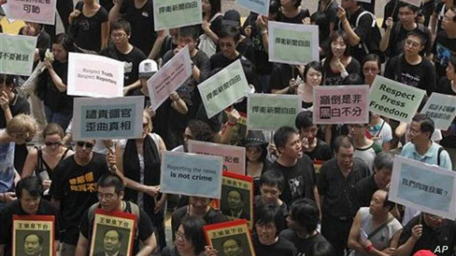 Hundreds of Hong Kong journalists, lawmakers and residents march to China's liaison office in Hong Kong protest the alleged police beatings of three reporters covering recent unrest in western China and demanded a government investigation (File Photo