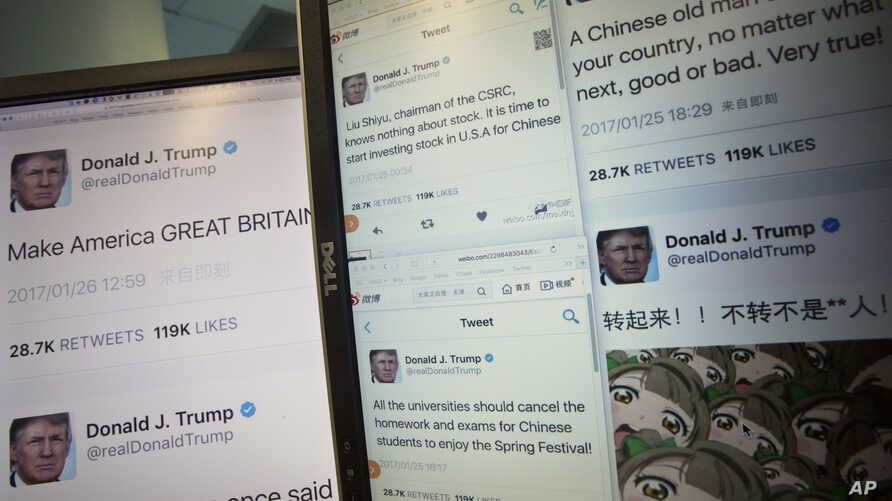 Computer screens display fake tweets that online users can self-generate at a Chinese website in Beijing, China, Jan. 26, 2017.