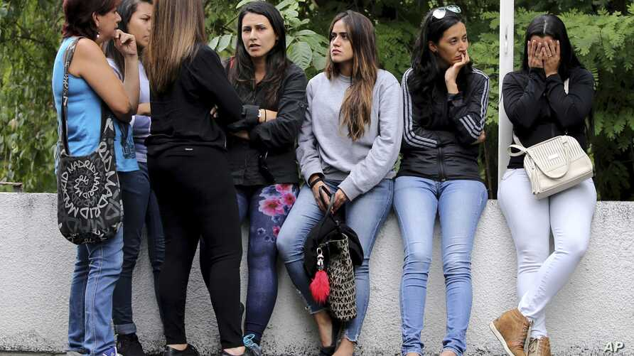 Women related to men who fought alongside the rebel police officer Oscar Perez wait for their loved ones' bodies to be turned over, outside the morgue in Caracas, Venezuela, Jan. 17, 2018. Seven people died fighting against police and soldiers Monday