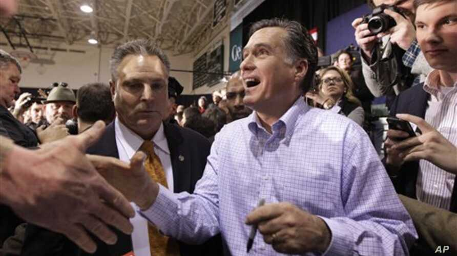 Republican presidential candidate, former Massachusetts Gov. Mitt Romney shakes hands as he campaigns during a town hall style meeting in Manchester, N.H., Wednesday, Jan. 4, 2012. (AP Photo/Stephan Savoia)