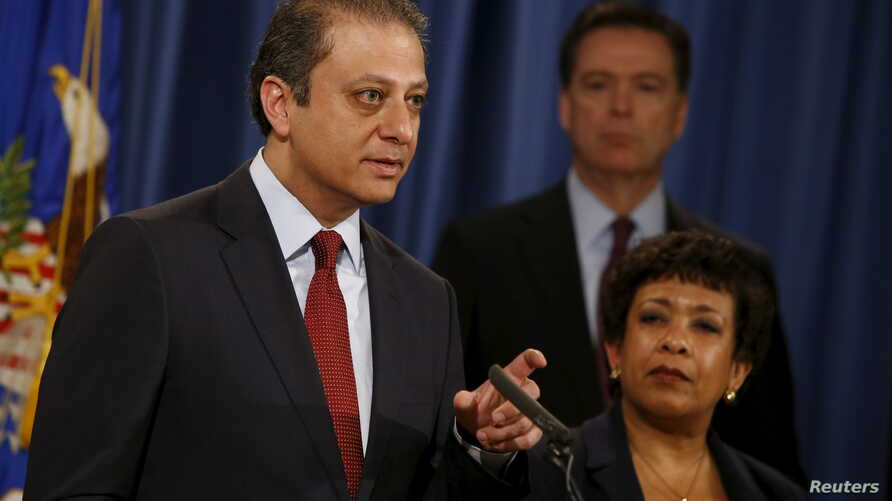 Manhattan U.S. Attorney Preet Bharara (L-R), Federal Bureau of Investigation Director James Comey and U.S. Attorney General Loretta Lynch hold a news conference to announce indictments on Iranian hackers for a coordinated campaign of cyber attacks in
