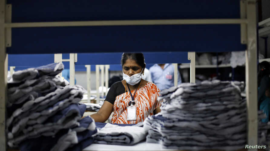 FILE - An employee sorts pieces of cloth at the Estee garment factory in Tirupur, in the southern Indian state of Tamil Nadu.
