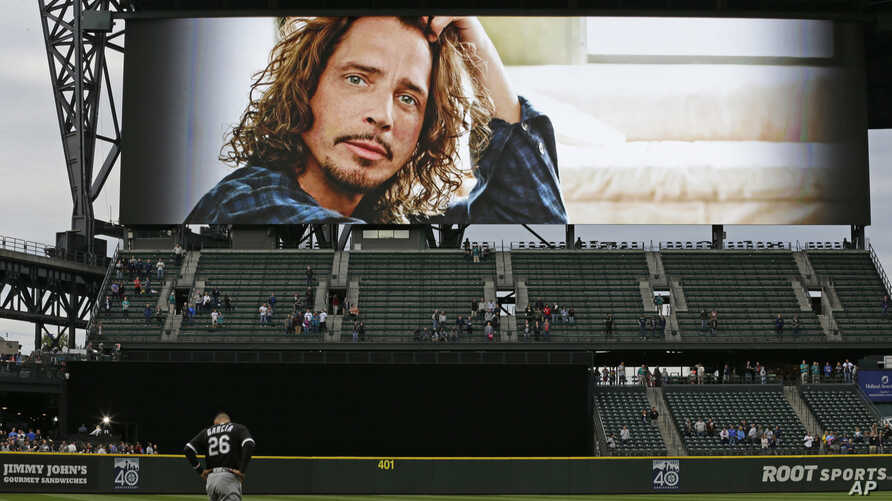 A tribute to singer Chris Cornell is shown on a video display at Safeco Field in Seattle before a baseball game between the Seattle Mariners and the Chicago White Sox, May 18, 2017. Cornell, who was born and raised in Seattle and was part of the grou