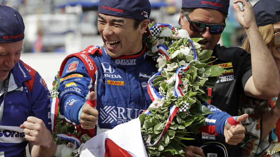 Takuma Sato, of Japan, celebrates on the start/finish line after winning the Indianapolis 500 auto race at Indianapolis Motor Speedway, May 28, 2017 in Indianapolis, Indiana.