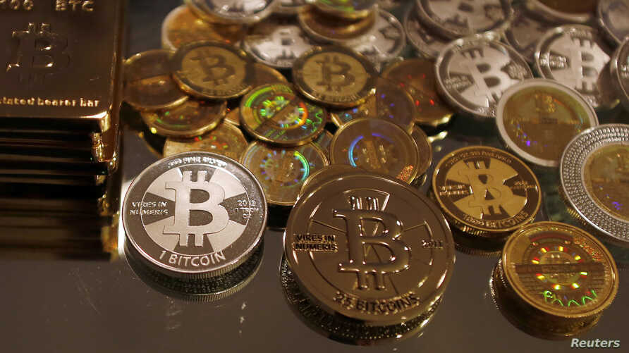 Bitcoins created by enthusiast Mike Caldwell are seen in a photo illustration at his office in Sandy, Utah, Sep. 17, 2013.