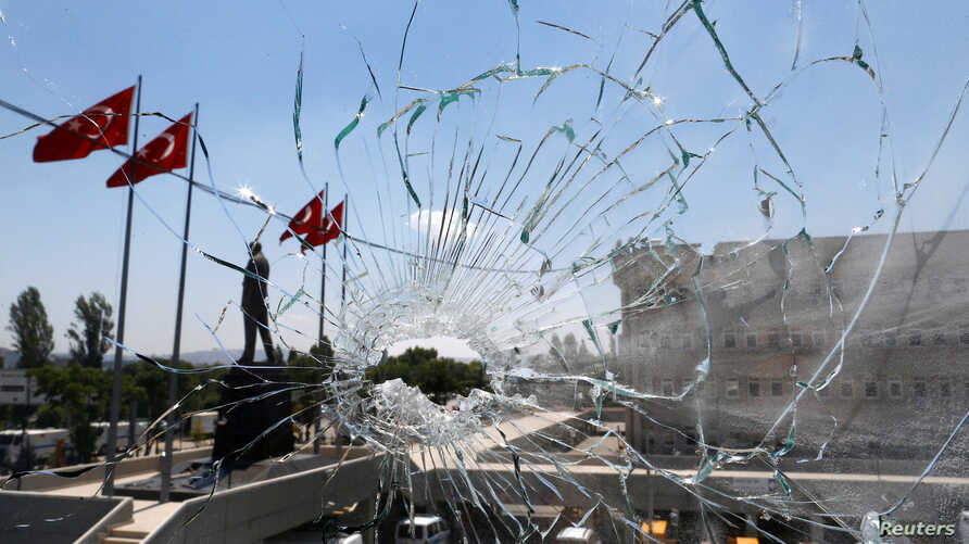 A damaged window is pictured at the police headquarters in Ankara, Turkey, July 18, 2016.